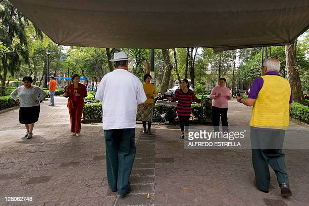STORY by Deborah Bonello A group of the elderly people dance 'danzon' at the Ciudadela Square in Mexico City on September 24 2011 The danzon a Cuban...