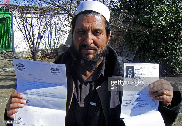 STORY 'AFGHANISTANUNRESTNATOUS' by Emmanuel Duparq In this photograph taken on January 21 2009 Afghan doctor Bilal Hassan holds the passport of his...