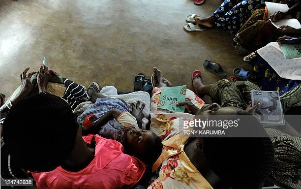 STORY by Emmanuel PEUCHOT A baby sleeps as Congolese women attend a lecture in a classroom at the Women for Women International an NGO based at Uvira...