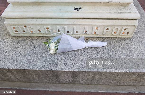 STORY by Fabienne Faur USliteraturemuseumeconomy Flowers rest on the burial site of US author Edgar Allan Poe at Westminster Hall in Baltimore...