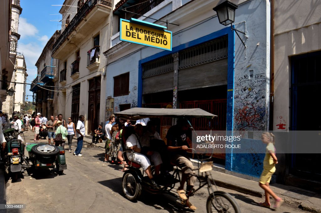 STORY by Francisco Jara Tourists visit the famous Bodeguita del Medio bar in the Cuban capital, Havana, on April 23, 2012. April 26 will mark the 70th anniversary of La Bodeguita del Medio where US writer Ernest Hemingway drank 'mojitos'.