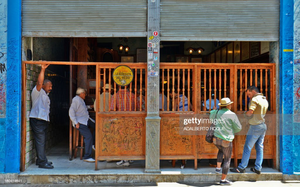 STORY by Francisco Jara Tourists visit the famous Bodeguita del Medio bar in the Cuban capital, Havana, on April 23, 2012. April 26 will mark the 70th anniversary of La Bodeguita del Medio where US writer Ernest Hemingway drank 'mojitos'.