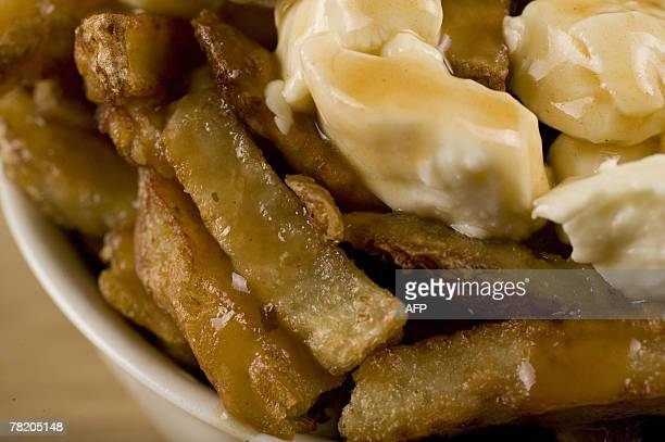 By Guillaume LAVALLEE CanadaUSAsocietygastronomy A popular Quebec dish called Poutine consisting of french fries cheddar cheese and gravy 20 November...