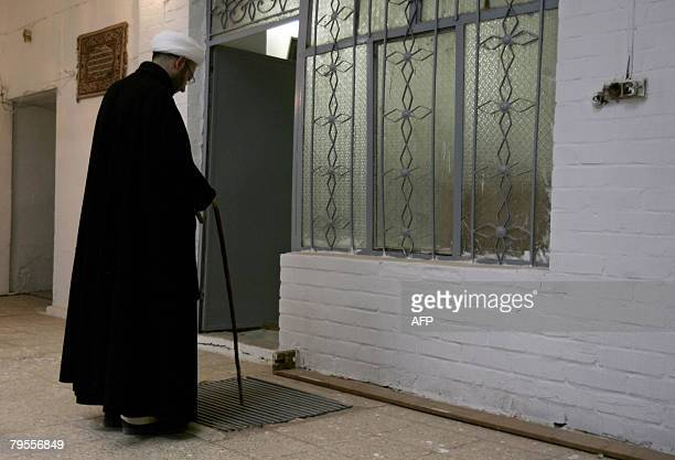 NAJAF by Hasan Abdul Zahraa Iraqi Shiite Cleric Sheikh Ahmed Kashef alGhataa points to a ventilation duct which leads to an ancient underground...