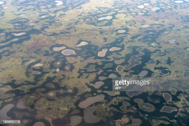 STORY by Hector Velasco Aerial picture of the Pantanal in Corumba a municipality in the Brazilian state of Mato Grosso do Sul on April 4 2013 Often...