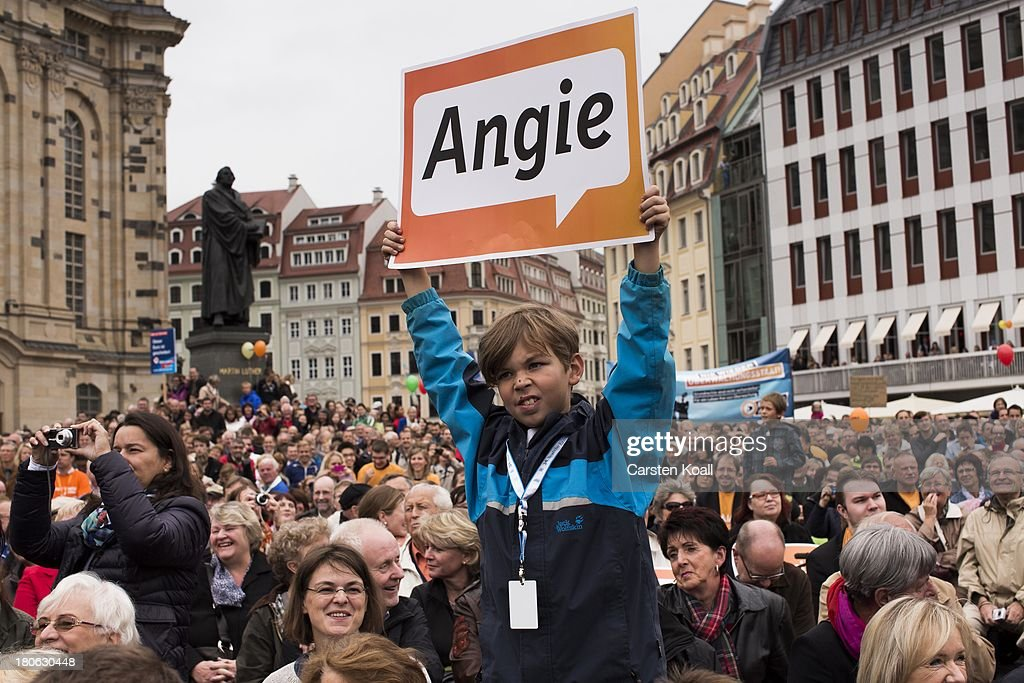 A by holds a banner with the written letters 'Angie', a nickname of German Chancellor and Chairwoman of the German Christian Democrats (CDU) Angela Merkel during CDU election campaign rally on September 15, 2013 in Dresden, Germany. Merkel has a strong lead over her political rivals and the CDU is expected to win federal elections scheduled for September 22
