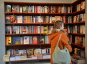 STORY by ISABELLE WESSELINGH and MIHAELA RODINA A woman looks at the contemporary Romanian literature bookshelf at a library in Bucharest March 21...
