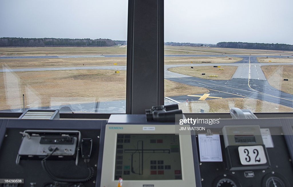 STORY by Ivan COURONNE, POLICY Landing and taxi runways are seen from the air traffic control tower at the Salisbury-Ocean City: Wicomico Regional Airport in Salisbury, Maryland, on March 21, 2013. The Federal Aviation Administration (FAA) is being forced to save 600 million USD between March and September 2013, as part of the automatic budget cuts, or sequester, approved by the US Congress and President Barack Obama. The FAA is considering closing half of the control towers of US small to midsize airports, some 238 like Salisbury, by April 7. AFP PHOTO/Jim WATSON