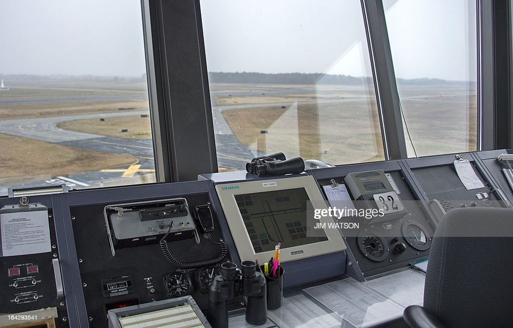 STORY by Ivan COURONNE, POLICY-ECONOMY-BUDGET-TRANSPORT AVIATION Landing and taxi runways are seen from the air traffic control tower at the Salisbury-Ocean City: Wicomico Regional Airport in Salisbury, Maryland, on March 21, 2013. The Federal Aviation Administration (FAA) is being forced to save 600 million USD between March and September 2013, as part of the automatic budget cuts, or sequester, approved by the US Congress and President Barack Obama. The FAA is considering closing half of the control towers of US small to midsize airports, some 238 like Salisbury, by April 7. AFP PHOTO/Jim WATSON
