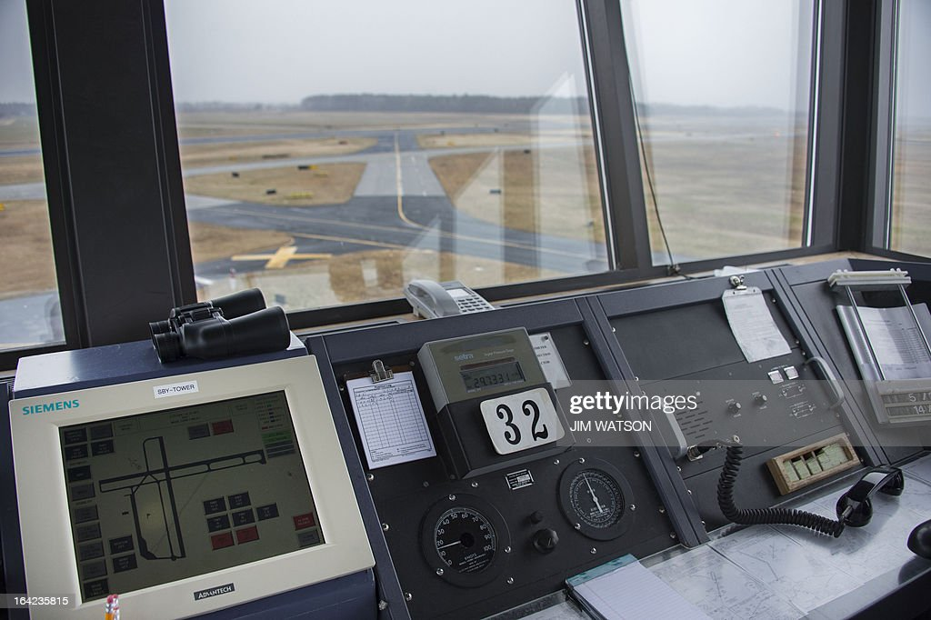 STORY by Ivan COURONNE, POLITIQUE-BUDGET-ÉCONOMIE-TRANSPORT-AVIATION Landing and taxi runways are seen from the air traffic control tower at the Salisbury-Ocean City: Wicomico Regional Airport in Salisbury, Maryland, on March 21, 2013. The Federal Aviation Administration (FAA) is being forced to save 600 million USD between March and September 2013, as part of the automatic budget cuts, or sequester, approved by the US Congress and President Barack Obama. The FAA is considering closing half of the control towers of US small to midsize airports, some 238 like Salisbury, by April 7. AFP PHOTO/Jim WATSON =MORE