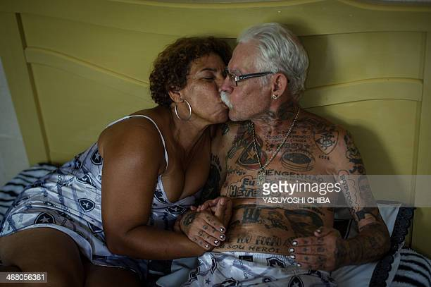 STORY by Javier Tovar Brazilian football club Botafogo fan Delneri Martins Viana a 69yearold retired soldier relaxes with his wife Vina at their home...