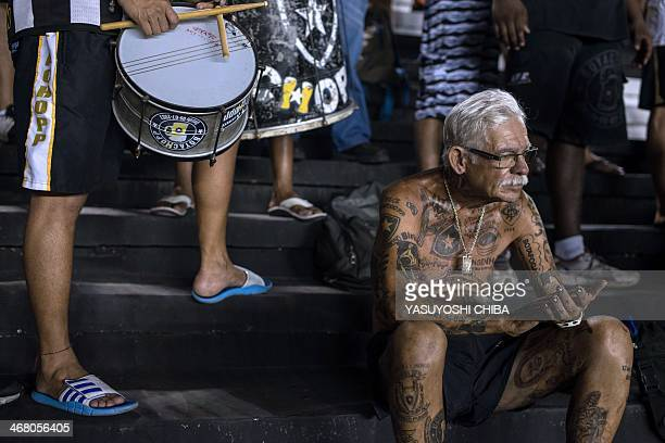 STORY by Javier Tovar Brazilian football club Botafogo fan Delneri Martins Viana a 69yearold retired soldier applauds at the team during a match at...