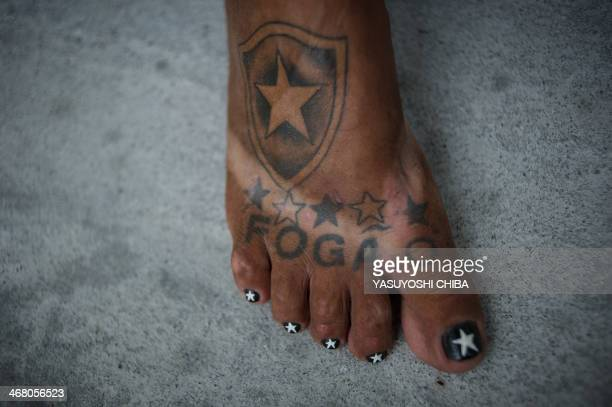 STORY by Javier Tovar Brazilian football club Botafogo fan Delneri Martins Viana a 69yearold retired soldier shows his tattoos at his home in Rio de...