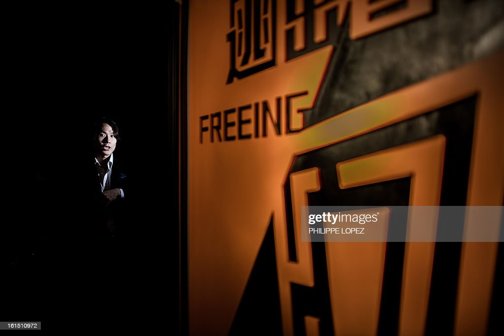ESCAPE by Joe Sinclair In this picture taken on January 28, 2013, Freeing HK creator Instant Wan looks on next to a logo of his company in Hong Kong. Freeing HK is a 'real escape game' in which players are pitted against a ticking clock as they desperately try to work their way out of the room by finding clues, cracking codes, and solving puzzles. AFP PHOTO / Philippe Lopez