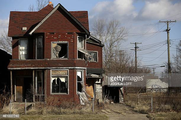 STORY by Joe Szczesny UScityDetroitautodebt Curtains flap outside the broken window of an abandoned home December 31 2014 in Detroit Michigan After...