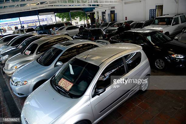 STORY by Jordi Miro Picture taken at a car dealer in Caracas on October 30 2012 Venezuela the country with the largest oil reserves and the world's...