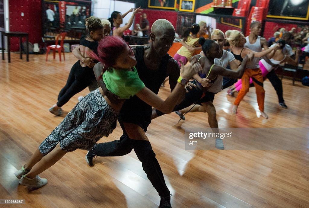 STORY by Jose Bautista Men and women take a dance class at the salsa music school 'Swing Latino' in Cali Colombia on September 20 2012 Thousands of...