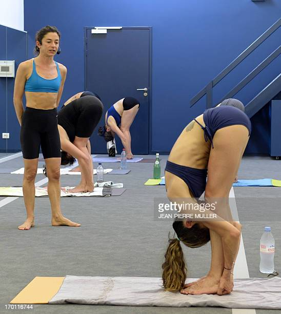 STORY by Julie FRAYSSE A teacher gives advice during a session of Bikram yoga conceived by ' guru' Bikram Choudry in a local hall in Bordeaux on June...