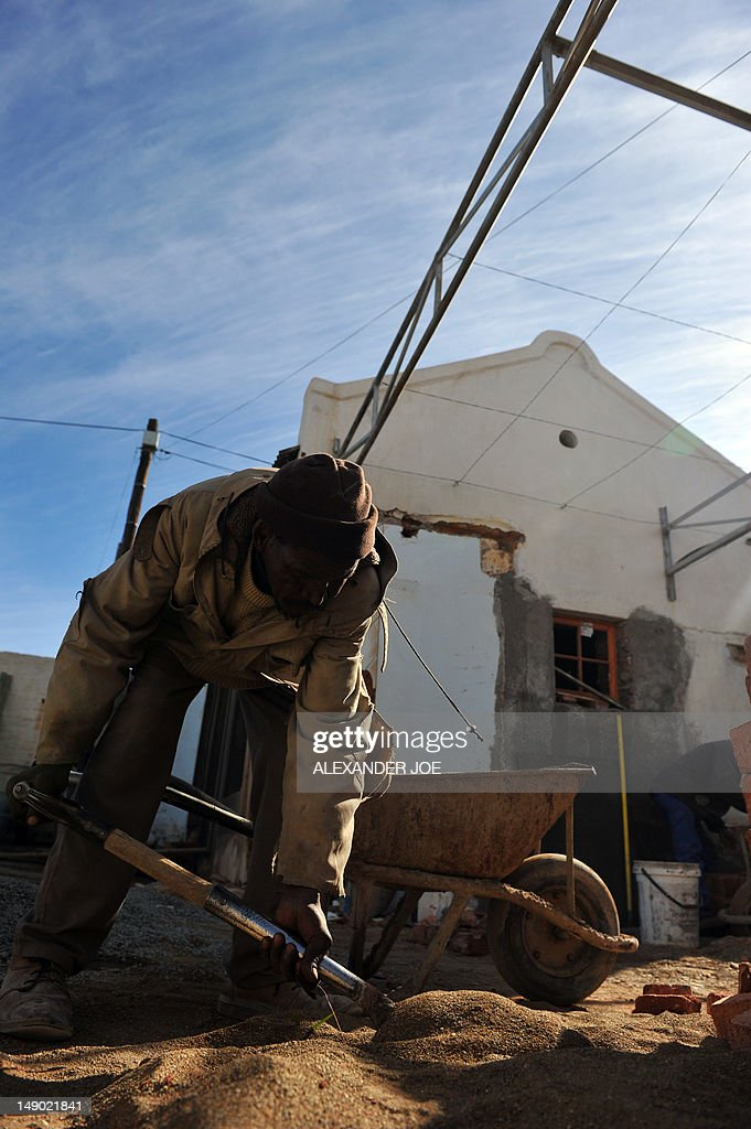 STORY by Justine Gerardy A picture taken on July 7, 2012 shows a man working on a construction site in Carnavon. The sleepy South African town of Carnarvon has more churches than ATMs, but science is breathing new life into the far-flung farming centre. The former 19th century mission station is the closest town to the science and astronomy hub that is forming in the arid central Karoo where the Square Kilometre Array (SKA) mega-telescope will be built.