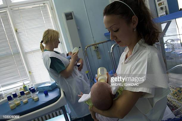 STORY by Katarina Subasic Nurses feed newborn babies from bottles on April 9 2010 in Belgrade Despite figures showing Serbia ranks below the southern...