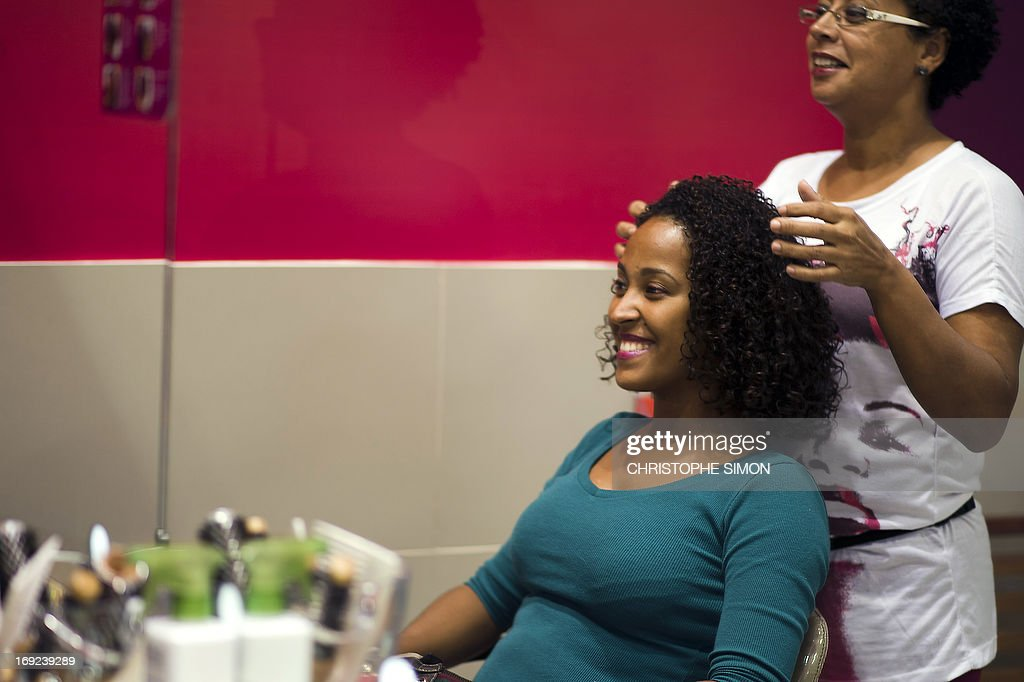 STORY by LAURA BONILLA A customer smiles after having her hair done at a hairdresser's specialized in curling hair --Afro-style hairdressing-- in Rio de Janeiro, Brazil on May 7, 2013.