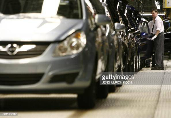 STORY by LENAIG BREDOUX FILES A picture taken on January 24 2008 shows a worker assembling an Opel Corsa car at the plant of car maker Opel in...