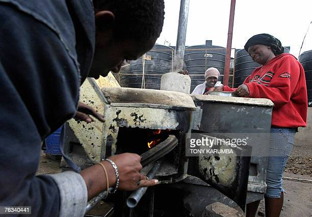 STORY by LUCIE PEYTERMANN FILES Picture made 11 August 2007 shows slum residents incinerating garbage and using the heat produced to cook on an...