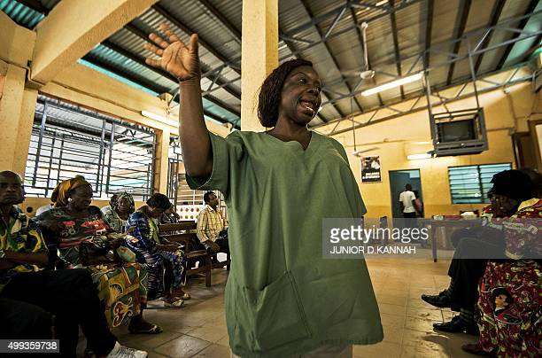 STORY by Marc JOURDIER Counselor Manziasi Elysee speaks at the MSF pharmacy in the town of Lingala on November 30 2015 The MSF AIDS project in...
