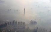 STORY by Marianne Barriaux A shroud of haze is seen whilst coming into land in the city of Zengzhou in central China's Henan province on November 6...