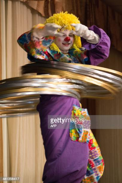 STORY by Mark Guarino Taylor Moss of Indiana spins hula hoops as part of the 'Joey' competition for child clowns at the World Clowning Association...
