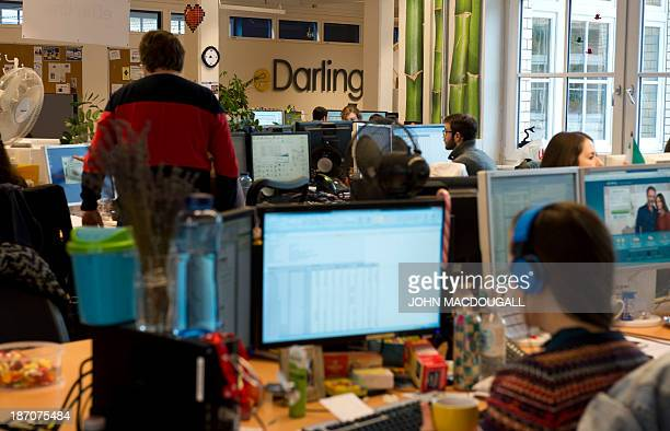 STORY by MATHILDE RICHTER Employees at work at the Berlin headquarters of international internet dating site eDarling November 5 2013 Founded in 2008...