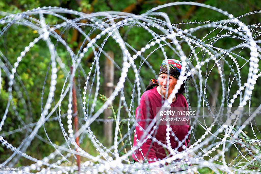 STORY by Max DELANY A woman looks through four-foot (1.2-metre) high coils of razor wire that divide the Russian-backed breakaway territory from Georgian-controlled land in village of Khurvaleti in Georgia on July 25, 2013. On the night of August 7-8, 2008, Georgia's pro-Western President Mikhail Saakashvili launched an offensive to reclaim breakaway region South Ossetia only to see Russian forces sweep into Georgia. The 2008 war between Georgia and Russia over the separatist region of South Ossetia may have only lasted five days.