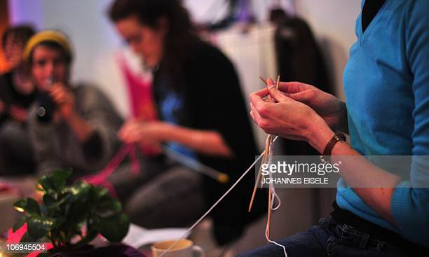 STORY by MECHTHILD HENNEKE Picture taken on November 17 2010 shows young women knitting during a meeting with their 'StrickenArt' group at the...