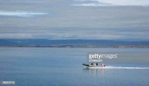 STORY by Michel Comte CanadaArcticmilitary A Canadian Navy Zodiac races across the Arctic Ocean on patrol at the southern tip of Baffin Island Canada...