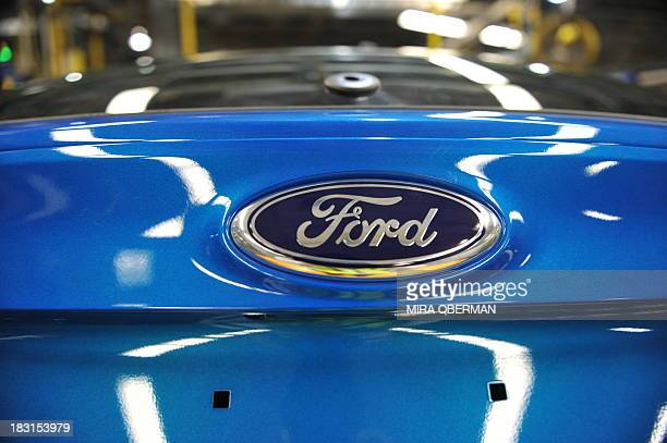 STORY by Mira OBERMAN USautohistorycompanyFord The Ford logo is seen on a newlybuilt Ford Focus at Ford's Michigan Assembly Plant on October 1 in...