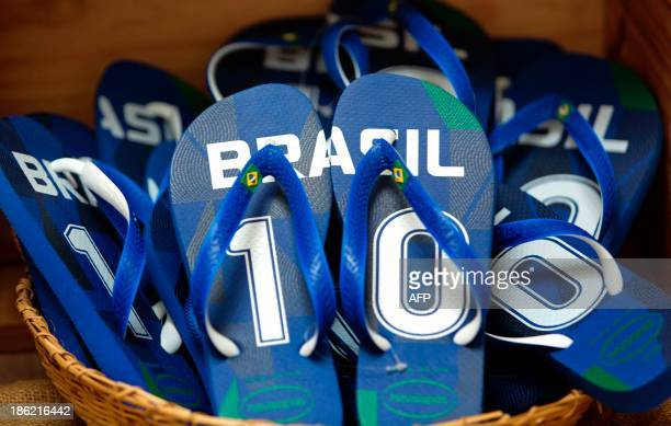 STORY by Natalia Ramos Brazilian Havaianas flipflops are sold at a stand in Sao Paulo Brazil on October 29 2013 AFP PHOTO / Miguel SCHINCARIOL / AFP...