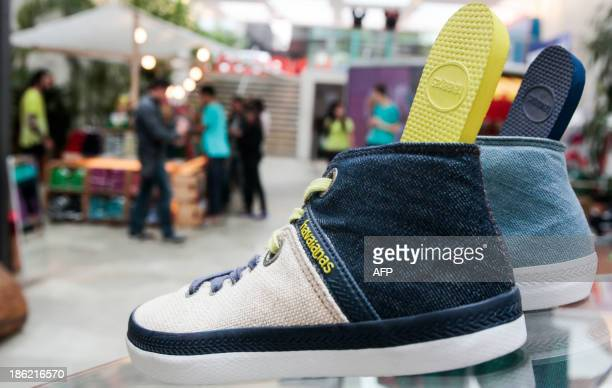 STORY by Natalia Ramos Brazilian Havaianas sneakers and the famous flipflops are sold at a stand in Sao Paulo Brazil on October 29 2013 AFP PHOTO /...