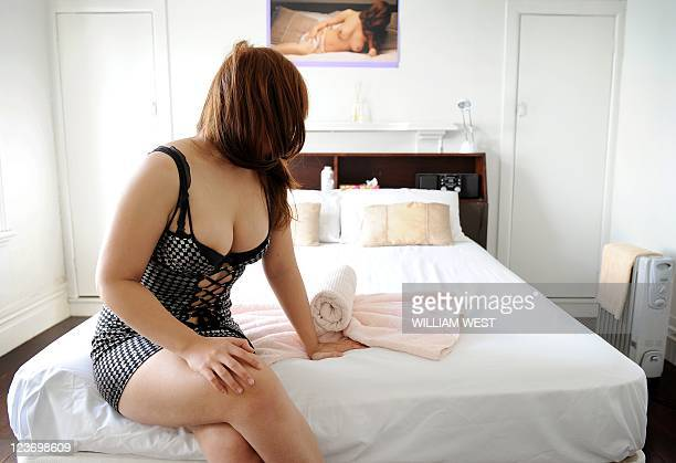 STORY 'RUGBYUWC2011NZLSEX' by Neil Sands In this picture taken on September 2 2011 sex worker 'Danni' poses in a room at Christina's brothel and...