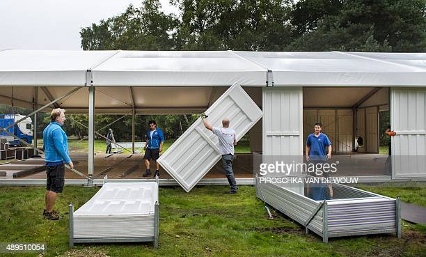 STORY by Nicolas Delaunay and Jan Hennop People build a refugee camp in Nijmegen on September 19 2015 Deep in a tranquil Dutch forest a...