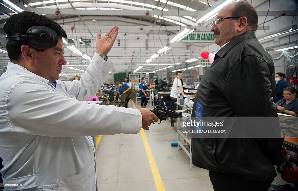 STORY by Nina Negroni Colombian businessman Miguel Caballero prepares to make a test firing a .38 caliber revolver against a leather jacket with bulletproof protection, at his factory on the outskirts of Bogota, on December 28, 2012. For 20 years, Miguel Caballero has designed and produced body armour for officers and personalities around the world, but is now also working in a line bullet-and-stab-proof wear for children to sell in the US. On the heels of the deadly shooting tragedy in Connecticut, US, in which 20 children and six women were killed, parents' anxiety is driving a surge in sales of bullet-proof backpacks, in the hope the armored bags can give their kids a safety edge. AFP PHOTO/Guillermo Legaria
