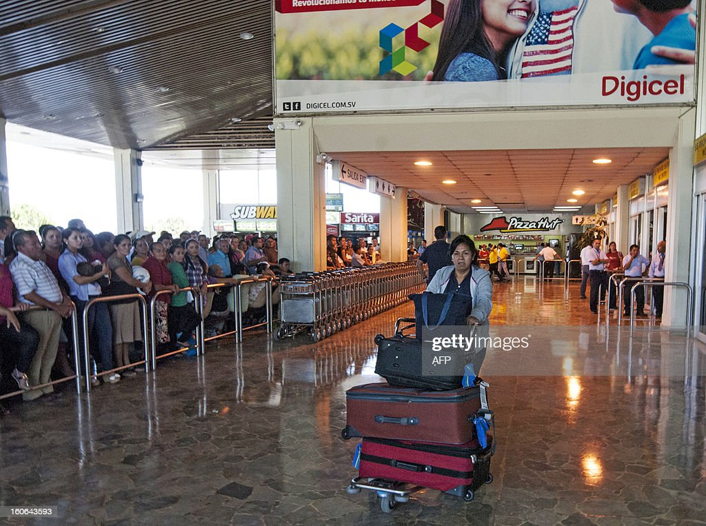 STORY by Oscar Batres A woman carries her luggage at Comalapa International Airport, 44 km south of San Salvador, as people wait for their loved ones -- some deported from the US, on February 1, 2013. From the 3 million Salvadorans living abroad, 2.5 million are doing so in the United States. In the US, where there are an estimated 11 million undocumented immigrants, immigration reform -- one of President Barack Obama's big promises -- will be one of the first topics of debate in the new Congress, if the tug-of-war over the debt ceiling does not get in the way. AFP PHOTO/Juan CARLOS