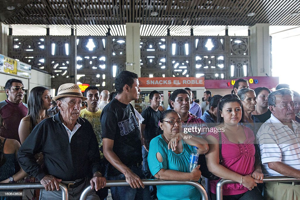 STORY by Oscar Batres Salvadorans wait for their loved ones -- some deported from the US -- at Comalapa International Airport, 44 km south of San Salvador, on February 1, 2013. From the 3 million Salvadorans living abroad, 2.5 million are doing so in the United States. In the US, where there are an estimated 11 million undocumented immigrants, immigration reform -- one of President Barack Obama's big promises -- will be one of the first topics of debate in the new Congress, if the tug-of-war over the debt ceiling does not get in the way. AFP PHOTO/Juan CARLOS