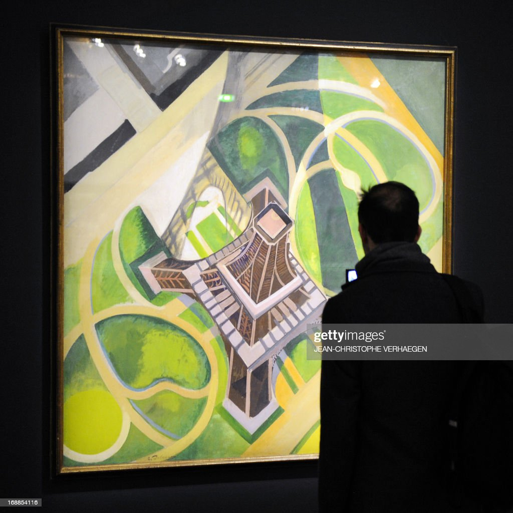 STORY by PASCALE MOLLARD - A journalist looks at the painting 'Tour Eiffel et Jardins du Champ-de-Mars' dated 1922 by Robert Delaunay during the presentation of the exhibition 'Vues d'en haut' at the Centre Pompidou in Metz, eastern France, on May 14, 2013.