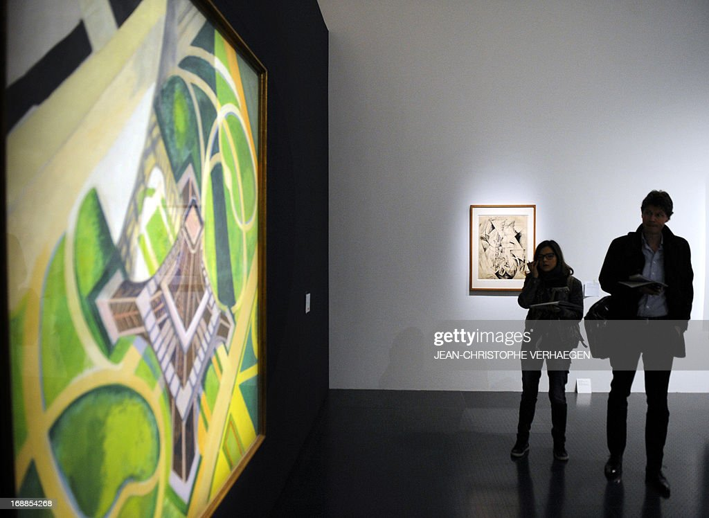 STORY by PASCALE MOLLARD - Journalists look at the painting 'Tour Eiffel et Jardins du Champ-de-Mars' dated 1922 by Robert Delaunay during the presentation of the exhibition 'Vues d'en haut' at the Centre Pompidou in Metz, eastern France, on May 14, 2013.