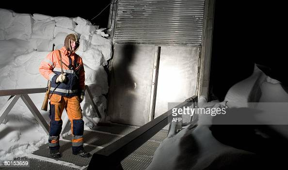 STORY by PierreHenry Deshayes 'NorvgeArctiquesocitanimauxours' An armed constuction worker keeps watch for polar bears outside the entrance of the...