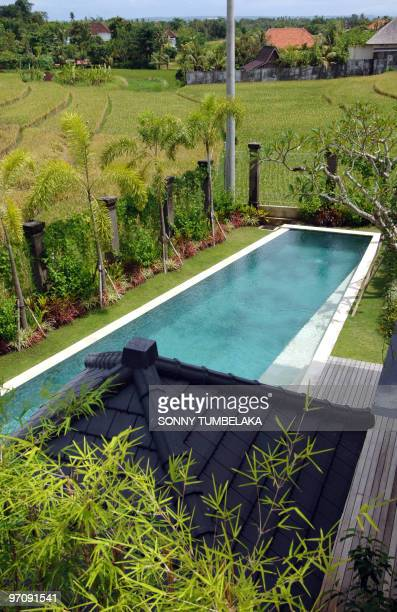 WITH 'INDONESIABALITOURISMENVIRONMENT' by Presi Mandari A newly built villa with a swimming pool is seen beside rice paddy field in Canggu area in...