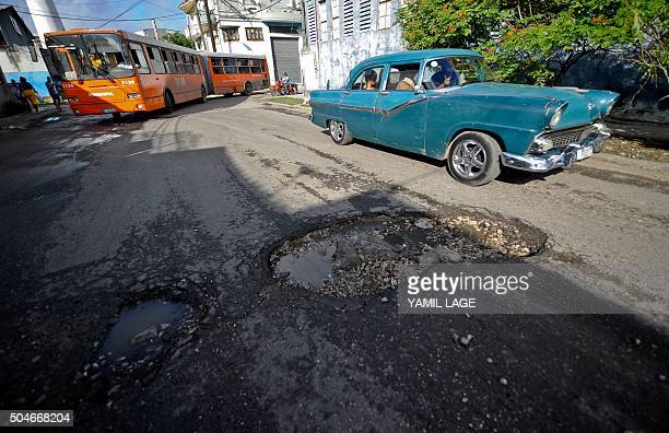 STORY by Rigoberto Diaz People drive cars along the streets of Havana on January 11 2016 A third of the cars riding in Cuba do so with mechanical...