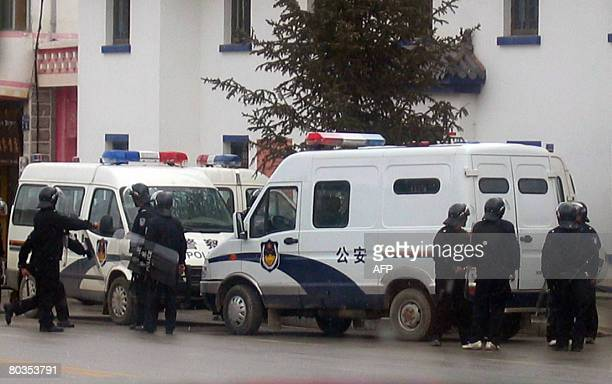 SHANGRILA by Robert Saiget Armed riot police near their vehicles patrolling the streets of Shangrila on March 23 2008 in the Deqen Tibetan Autonomous...