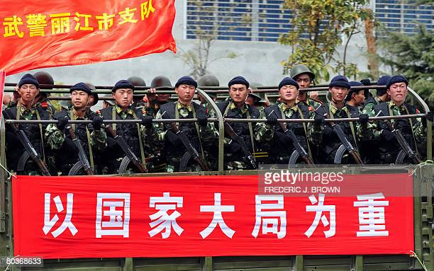 RELIGION by Robert Saiget Truckloads of armed paramilitary forces and in riot gear patrol the streets of Lijiang on March 24 2008 in southwest...