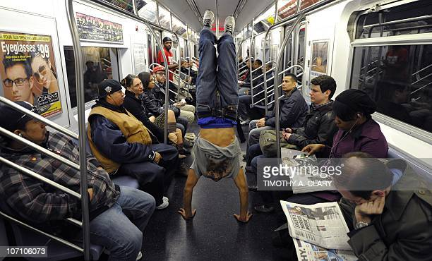 CULTURE by Sebastian Smith New York City Subway dancer Marcus Walden aka 'Mr Wiggles' performs acrobatic tricks on the subway while passengers watch...
